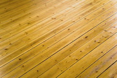 Wooden flooring. Details of modern wooden laminate flooring Royalty Free Stock Photos
