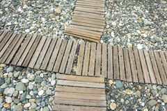 Wooden flooring on the beach. For comfortable walks Stock Images