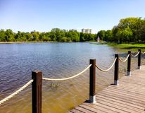 Wooden flooring on the lake shore. Wooden flooring on the lake in the city Park Stock Photos