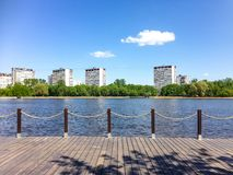 Wooden flooring on the lake shore. Wooden flooring on the lake in the city Park Royalty Free Stock Photos