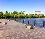 Wooden flooring on the lake shore. Wooden flooring on the lake in the city Park Stock Photography