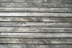 Wooden floors of the terrace on the river bank. Texture of wet unpainted wood