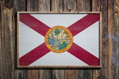 Wooden Florida flag. 3d rendering of a Florida State USA flag on a wooden frame and a wood wall Stock Images