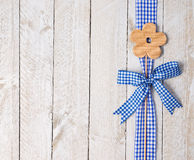 Wooden flower and blue ribbon Stock Photos