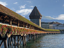 Wooden flower decorated bridge. Wooden flower decorated Chappel bridge in Lucerne word heritage Royalty Free Stock Photos