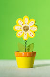 Wooden flower notes holder on a green background. Colored wooden flower notes holder on a green background Royalty Free Stock Images