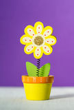 Wooden flower notes holder on a purple background. Colored wooden flower notes holder on a purple background Royalty Free Stock Images