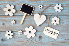 Wooden flowers and heart with calk board on a old wooden background with empty space layout Royalty Free Stock Images