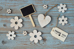 Wooden flowers and heart with calk board on a old wooden background with empty space layout Royalty Free Stock Photography