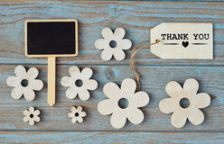 Wooden flowers and heart with calk board on a old wooden background with empty space layout Stock Photos