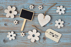 Wooden flowers and heart on a old wooden background with thank for you   label and  and black chalk board empty space layout Royalty Free Stock Image