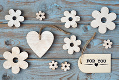 Wooden flowers and heart on a old wooden background with thank for you   label and  and black chalk board empty space layout Royalty Free Stock Images