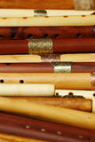 Wooden flutes. Close-up of raft of wooden flutes stock images