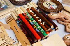 Wooden flutes, icons, forks and other products royalty free stock photography