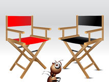 Wooden foldable Director chair. And ant character Royalty Free Stock Image