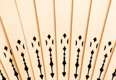 Wooden folding fan background Stock Images