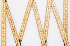Wooden folding ruler isolated on a white background with a clipping path. royalty free stock images