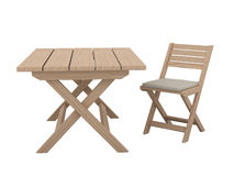 Wooden folding table and chair. Stock Photos