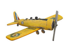 Wooden folk art airplane toy isolated. Stock Photo