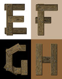 Wooden font - latter E F G H. Stock Images