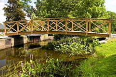 Wooden Foot bridge. Wooden footbridge over a waterway at an old New England mill stock photos