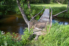 Wooden foot bridge. Over a pond Royalty Free Stock Photography