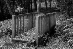 Wooden Foot Bridge. Black and white of a wooden foot bridge in a park Stock Photo