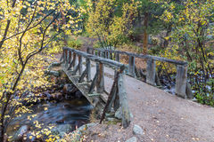 Wooden Foot Bridge Over the Stream Stock Images