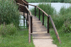 WOODEN FOOT BRIDGE OVER WATER Stock Photos