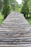 Wooden foot bridge. Wooden foot bridge in the park with trees Royalty Free Stock Images