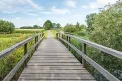 Wooden foot bridge in a rural landscape Stock Photos