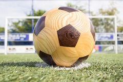 Wooden football on penalty spot with goal Stock Photos