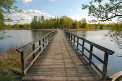 Wooden footbridge. Spanning a lake.  Valens.  Ontario.  Canada Stock Photos