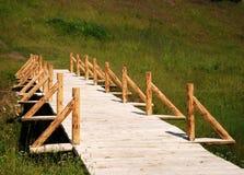 Wooden footbridge. Making the wooden footbridge over the runnel Stock Photography