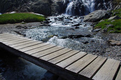 Wooden footbridge in the Alps Royalty Free Stock Image