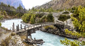 Wooden footbridge on the annapurna circuit, nepal stock images