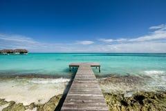 Wooden footbridge on beach stock images