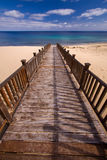 Wooden footbridge on the beach Stock Images