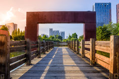 Wooden footbridge in city garden Stock Photos