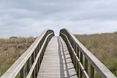 Wooden footbridge in the dunes Stock Photo