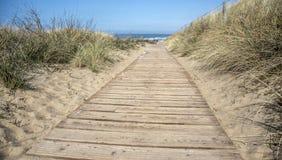 Wooden footbridge in the dunes Stock Photo