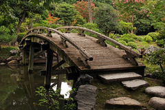 Wooden footbridge in japanese garden Stock Photo