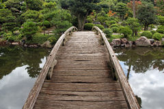 Wooden footbridge in japanese garden Stock Images