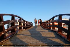 Wooden Footbridge, Lefkada, Greece. A wooden footbridge over the inner lagoon or marina in the Ionian Greek island Lefkada, at sunset stock photo