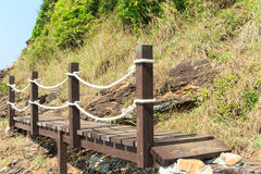 Wooden footbridge near the sea. Wooden footbridge near the beach royalty free stock image
