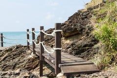 Wooden footbridge near the sea. Wooden footbridge near the beach stock image