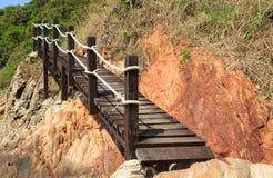 Wooden footbridge near the sea. Wooden footbridge near the beach royalty free stock photo