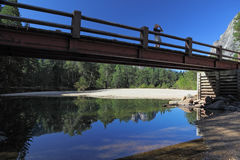 Wooden footbridge over the Merced River Stock Photo