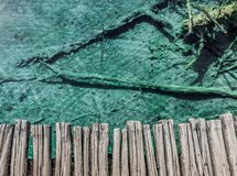 Footbridge with a tropical mood and fantastic transparent water stock images