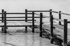 Wooden footbridge over water lake in a park Stock Photos